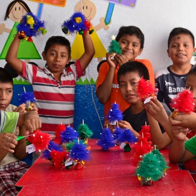 The children made christmas trees to sell to raise money.