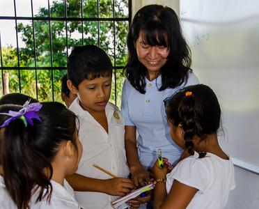 Teacher Lorena with students.