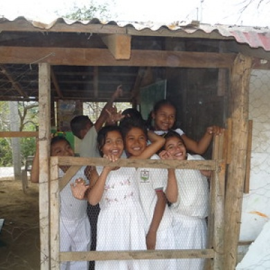 Happy children in old classroom. Door was chicken wire.